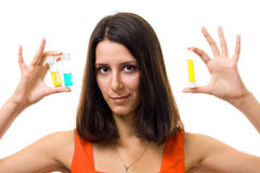 Woman with test tubes Royalty Free Stock Photography