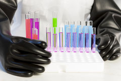 Woman with test tubes Royalty Free Stock Image