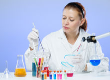 Woman with test tubes in a chemistry Royalty Free Stock Images