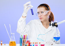 Woman with test tubes in a chemistry Stock Image