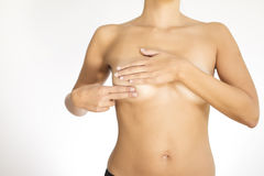 Woman testing her breast for cancer Royalty Free Stock Photo