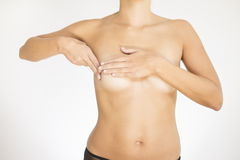 Woman testing her breast for cancer Royalty Free Stock Image