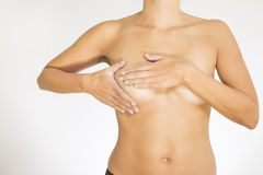 Woman testing her breast for cancer Stock Photography