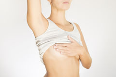 Woman testing her breast for cancer Royalty Free Stock Photography
