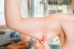 Woman is testing her muscle under her arm Stock Photo