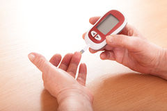 Testing for high blood sugar. Stock Photos