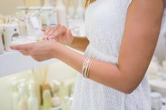 Woman testing moisturizer Stock Photography