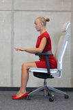 Woman testing office chair Stock Image