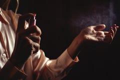 Woman testing perfume Royalty Free Stock Photo