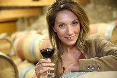 Woman testing the red wine. Woman tasting red wine in cellar Stock Photo