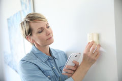Woman testing the thermostat temperature Royalty Free Stock Photography