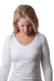 Woman tests nuchal rigidity. meningitis Stock Photo