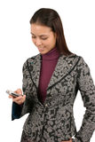 Woman text messaging. Attractive young business woman sending a text message Stock Photography