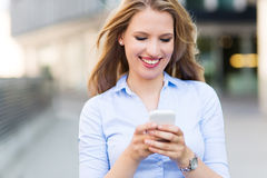 Woman text messaging Stock Photos