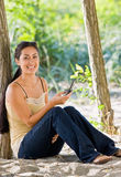 Woman text messaging on cell phone at beach Royalty Free Stock Photo