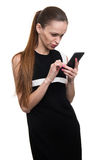 Woman text messaging on a mobile phone Stock Photo