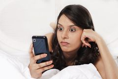 Woman text messaging on a mobile phone Stock Photos