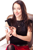 Woman is text messaging using smartphone Royalty Free Stock Photography