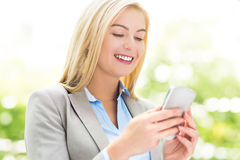Woman text messaging Royalty Free Stock Photography