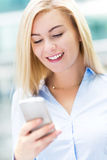 Woman text messaging Royalty Free Stock Photos
