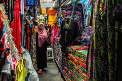 Woman in the textile market in Solo, Indonesia. Woman in the textile market in Solo on Java Island, Indonesia Royalty Free Stock Image