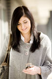 Woman texting Stock Images
