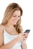 Woman texting on cell Stock Photography