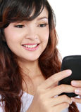 Woman texting on cell phone Royalty Free Stock Images