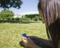 Woman texting on cell phone Stock Photo