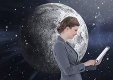 Woman Texting in front of moon royalty free stock photo