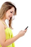 Woman texting on her cell Royalty Free Stock Photo