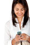Woman texting on her cell Stock Images
