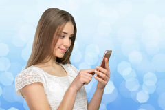 woman texting on her cell phone Royalty Free Stock Photo