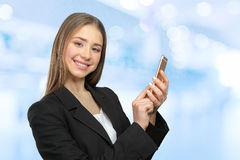 Woman texting on her cell phone Royalty Free Stock Photos