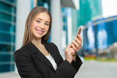 Woman texting on her cell phone Stock Photos