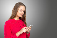 Woman texting on her cell phone Stock Images