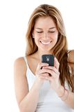 Woman texting on her mobile Royalty Free Stock Photos