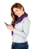 Woman texting on her phone Stock Photography