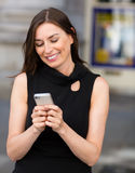 Woman texting on her phone Stock Image
