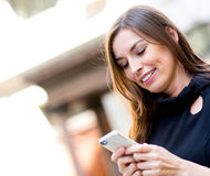 Woman texting on her phone Stock Photos