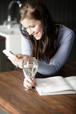 Woman texting on her phone Stock Photo