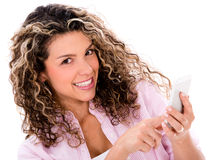 Woman texting on her phone Royalty Free Stock Photography