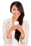 Woman texting on her phone Stock Images