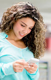 Woman texting on her phone Royalty Free Stock Photos