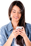 Woman texting on her phone Royalty Free Stock Images