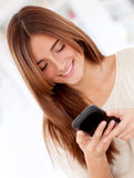 Woman texting from her phone Royalty Free Stock Photos