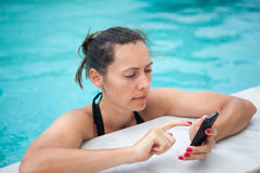 Woman texting from holidays Royalty Free Stock Images