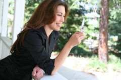 Woman Texting at Home Stock Image