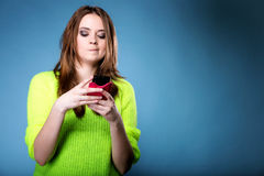 Woman texting while looking surprised on phone Royalty Free Stock Photos