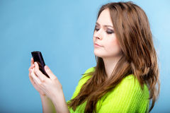 Woman texting while looking surprised on phone Stock Photos